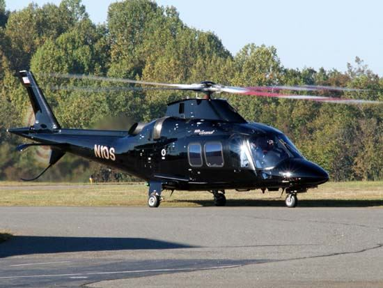Black Helicopter Sitting on Runway