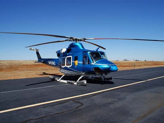 Blue Helicopter Sitting on Runway