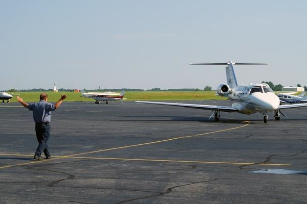 Airport Employee Guiding in a Plane Landing at the Rowan County Airport