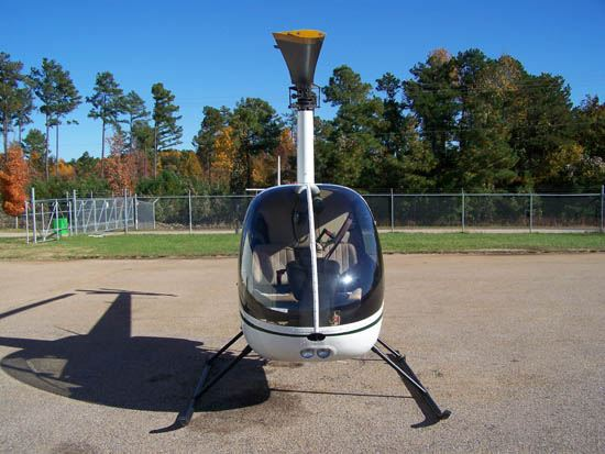 Front View of Helicopter With Tree in Background