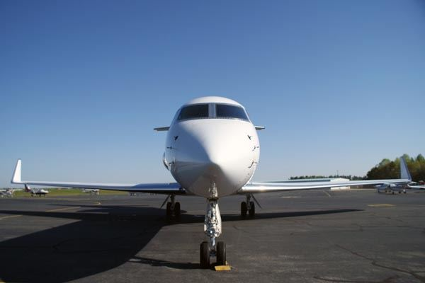 Front View of Nose of Airport Sitting on Runway
