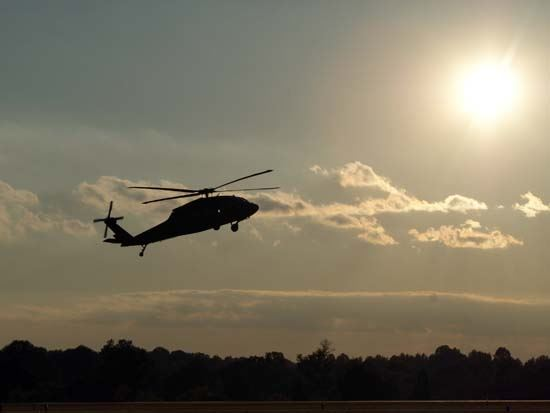 Helicopter Taking off as Sun Begins to Set at the Airport