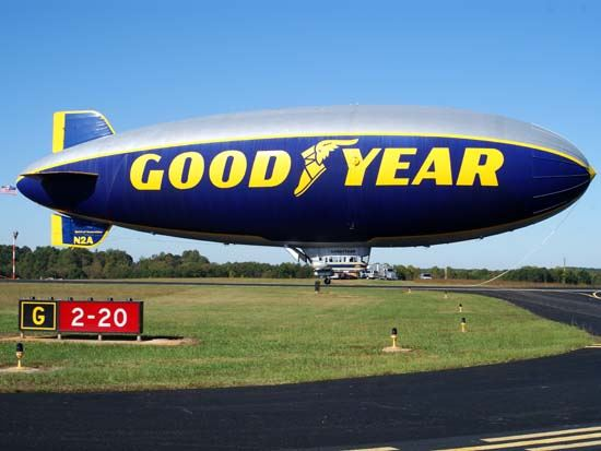 Side View of Good Year Blimp Sitting on Runway